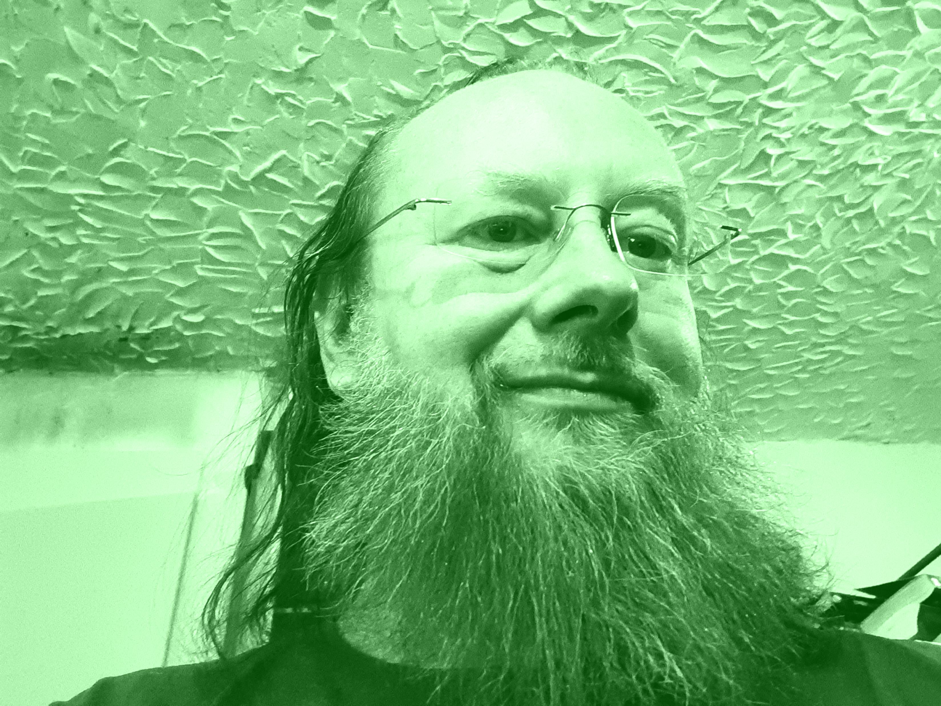 Ing. Arno Pucher in Grün mit Bart